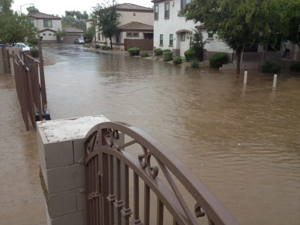 Flooded housing gated community during monsoon rain season, Phoenix, AZ